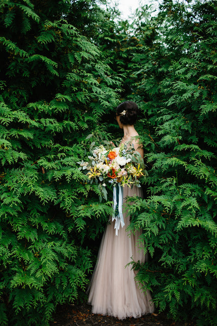 Wedding bouquet in green shrubs