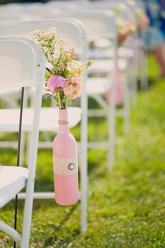 Aisle Decor with DIY decorated bottles | flowers by Stacy K Floral | pictures by Jovial Photography | Belhurst Castle in Geneva, NY | Outdoor Wedding | Spring Wedding Flowers