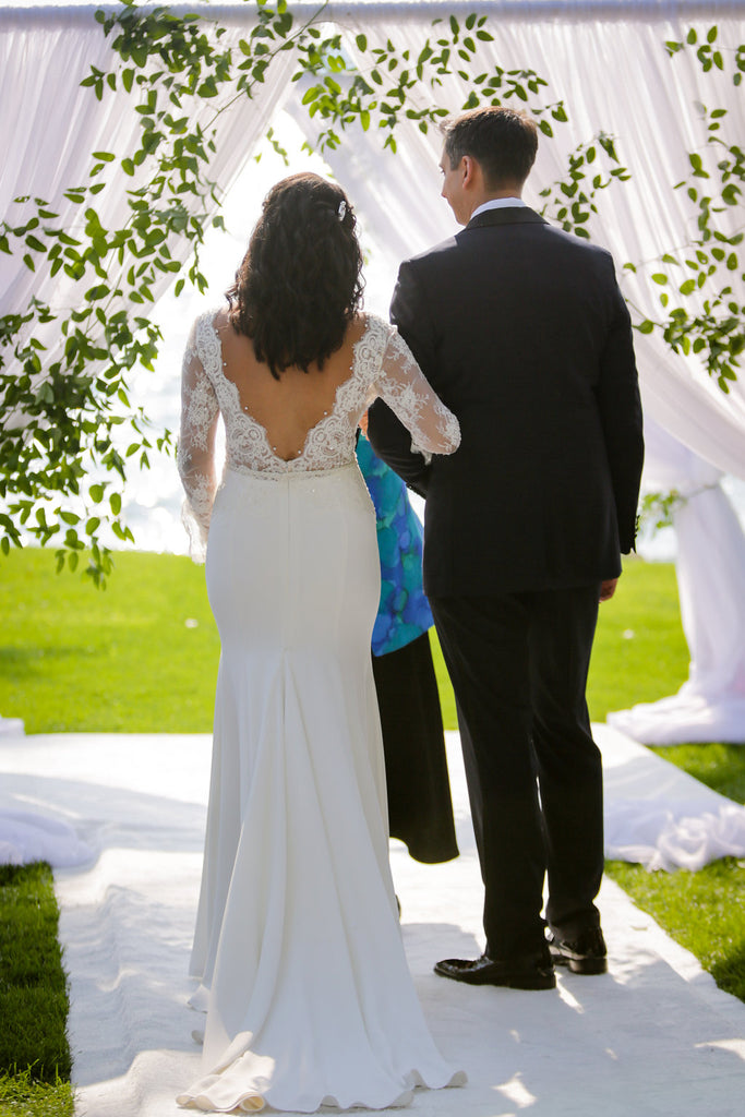 white fabric wedding arch on the lake at inns of aurora