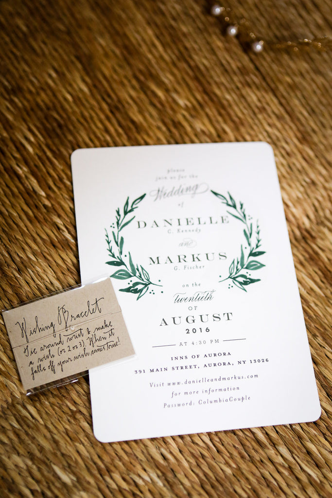 white and green wedding invitation