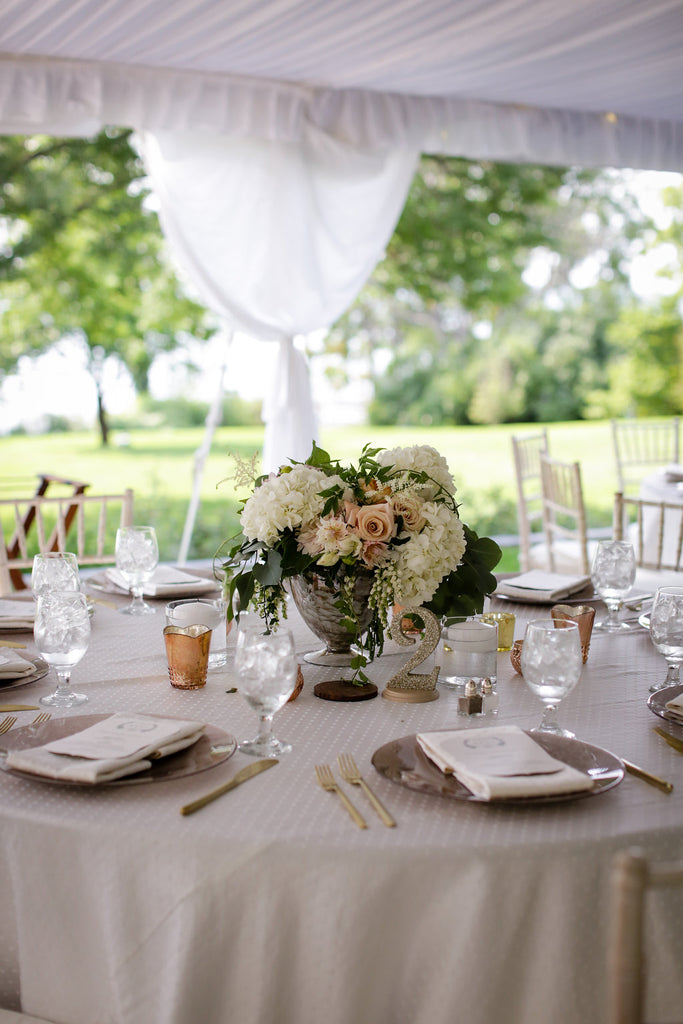 blush and white centerpiece with greenery