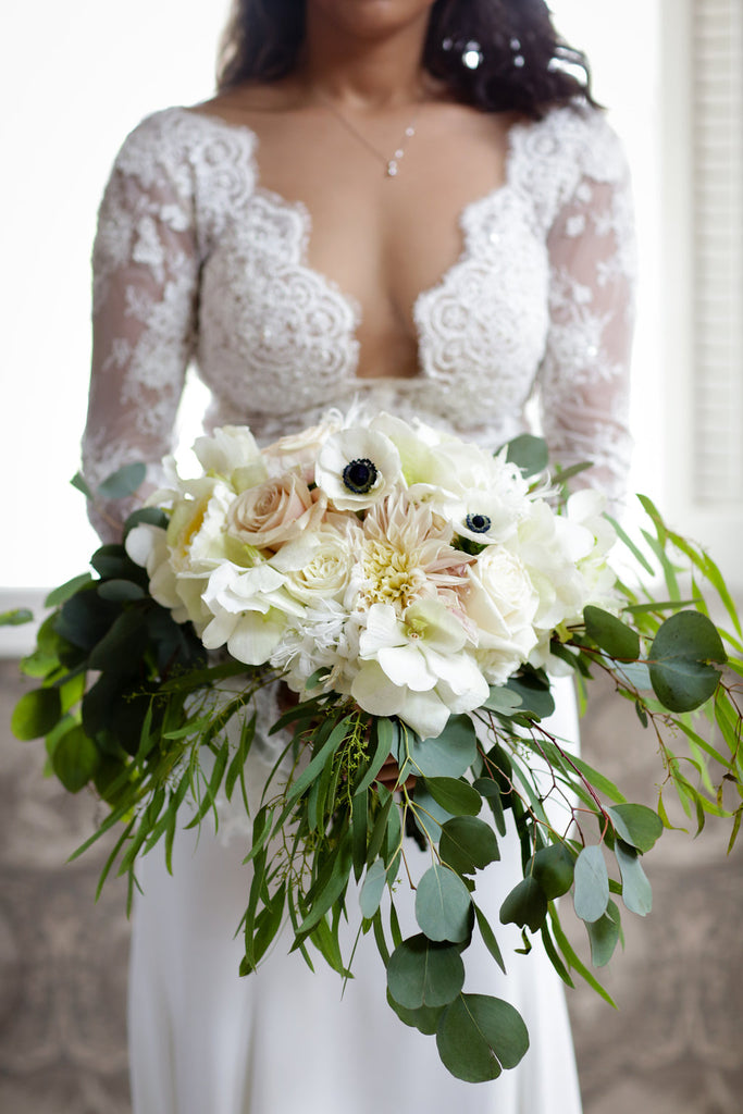bride with lace dress and blush and cream bouquet
