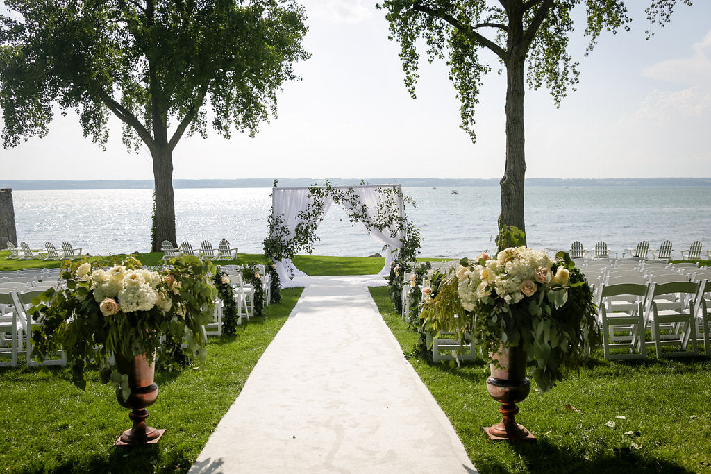 Wedding ceremony on the lake at Inns of aurora in white and blush