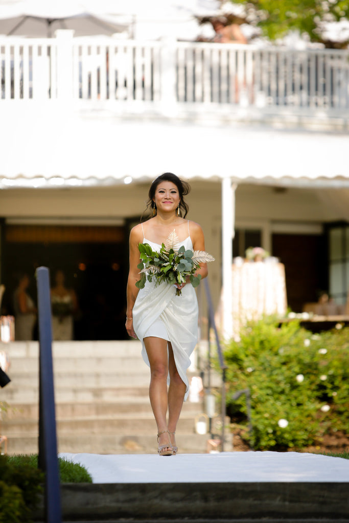 ivory bridesmaid dress greenery bouquet