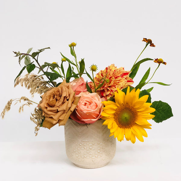 Stacy K Floral | Florist Rochester NY | The Petite Fall Arrangement includes fresh focal blooms in colors like soft pinks, taupe, yellow, orange, and red. Presented in a neutral pot.  Substitutions will be made based on availability.
