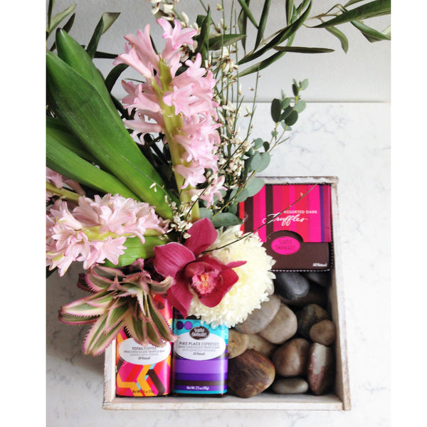 This gift box of chocolates and a bright bouquet is certain to put a smile on anyone's face.