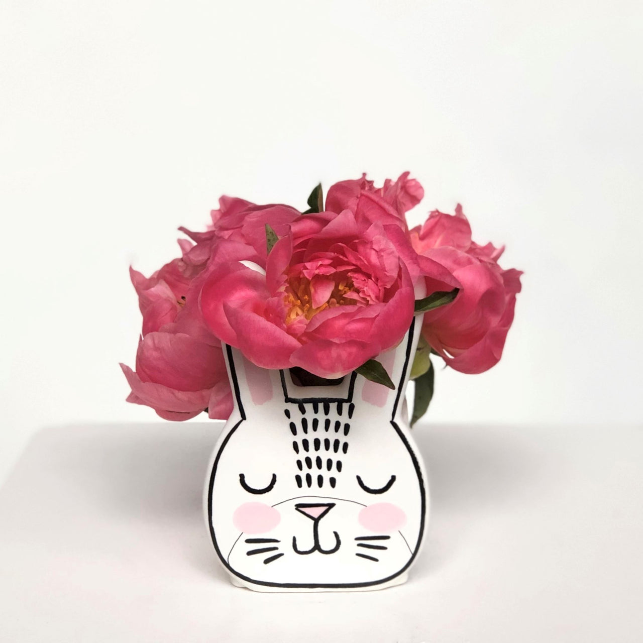 Stacy K Floral Blushing bunny floral arrangement Eye-catching bunny vase full of fresh peonies.