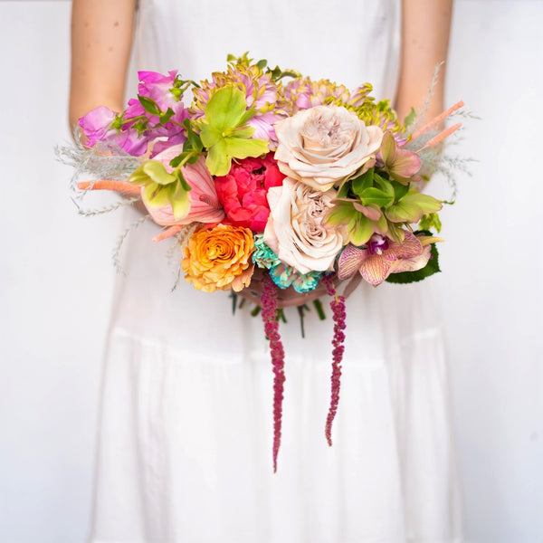 A beautiful bridesmaid size bouquet in our signature Stacy k Floral style.  It's super easy, just select the color variation your prefer, let us know any of your favorite blooms in the notes section of your order, add all items you need to your cart. Place your order for the selected delivery date and we will take it from there.   The bouquet ribbon color will be chosen to accentuate the flower, if you prefer a certain color let us know in the notes.