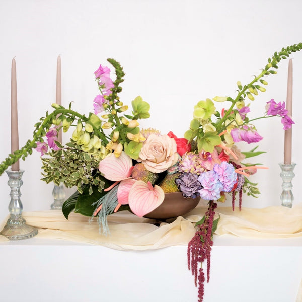 A large luxurious centerpiece in our signature Stacy K Floral style set in a compote bowl that is yours to keep.  It's super easy, just select the color variation your prefer, and price point and let us know any of your favorite blooms in the notes section of your order. Add all items you need to your cart and place your order for the selected delivery date.  We will take it from there.
