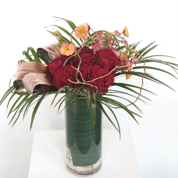 Half dozen premium roses paired with complimenting blooms to accent, in a cylinder vase. Specify color preference in special instructions upon checkout.