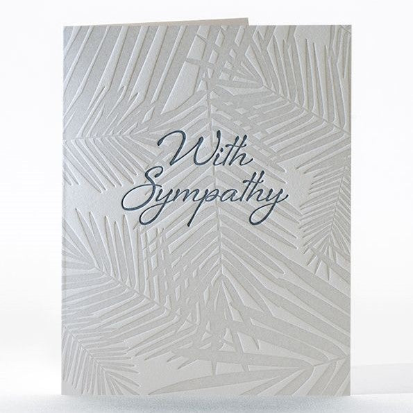 "This sympathy letterpress card is adorned with the slight shadow of softly sweeping palms and letterpress printed using soy-based inks on 100% cotton rag paper. Front reads ""with sympathy."" Inside reads ""Thinking of you during this difficult time"""