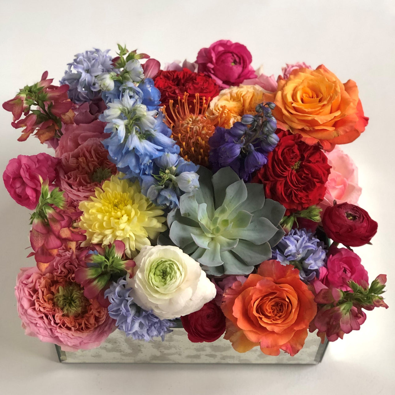 "Stacy K Floral Grand floral gift box; This show-stopping arrangement includes a colorful variety of fresh floral set in a keepsake mirror box.  Container measures 12"" x 12"" x 5"""