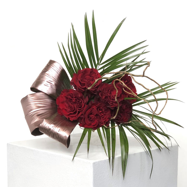 Half dozen roses, beautifully arranged, and embellished with seasonal greenery. Wrapped presentation style. Specify color preference in special instructions upon checkout.