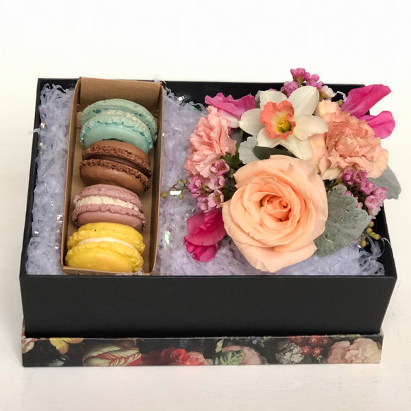 A beautiful floral gift box comes complete with gorgeous fresh blooms and five assorted French macarons from a local Rochester bakery.