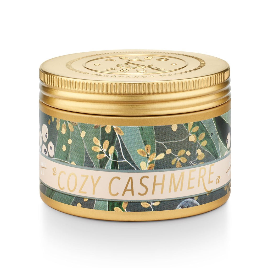 The Tried & True Small Tin Candle by Illume features a decorative label with seasonally inspired illustrations, making it the perfect gift.
