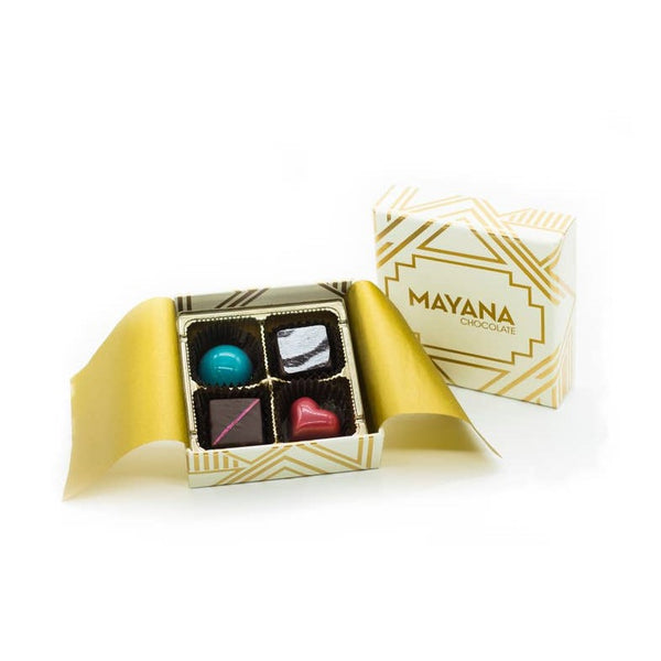 Mayana Chocolate 4 Piece Signature Collection in an ivory and metallic gold box.