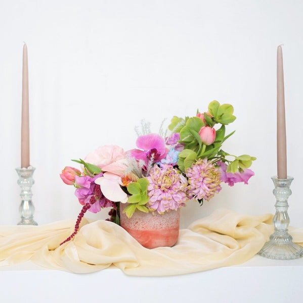 A mid size centerpiece in our signature Stacy K Floral style.  It's super easy, just select the color variation your prefer, and price point and let us know any of your favorite blooms in the notes section of your order. Add all items you need to your cart and place your order for the selected delivery date.  We will take it from there.