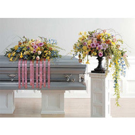 Garden inspired sympathy pieces full and lush with pastel garden blooms and foliage.