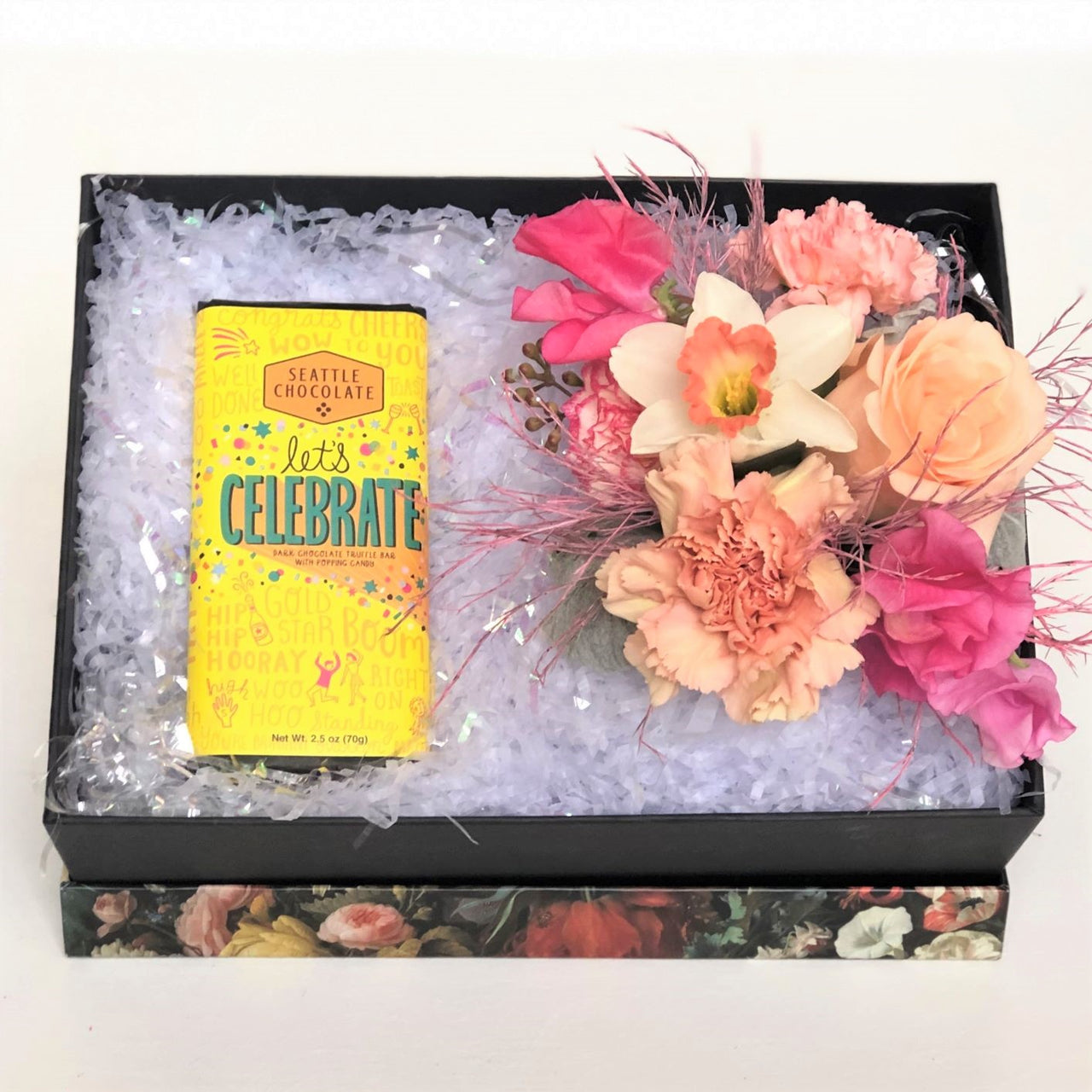 A beautiful petite floral gift box black box with a floral printed lid comes complete with gorgeous fresh blooms and a Seattle Chocolates chocolate truffle bar