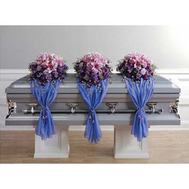 Set of three shades of purple and blue casket mounds with a fabric detail designed in color layers.