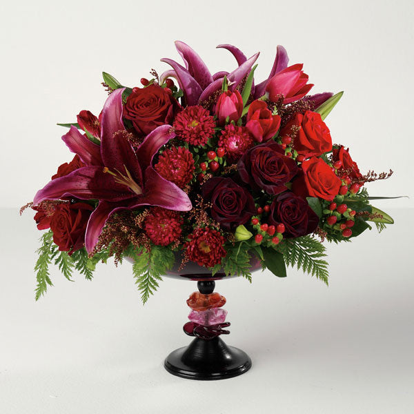 Filled with Lilies, roses, berries, tulips and other seasonal blooms.