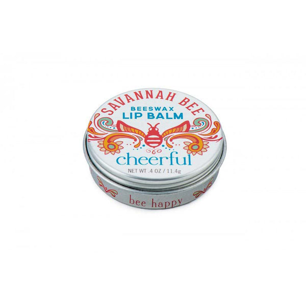 This Savannah Bee beeswax lip balm comes in a tin decorated with an ornamental bee design.