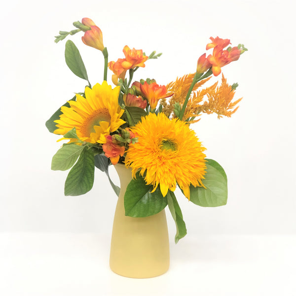 bright yellow vase arrangement