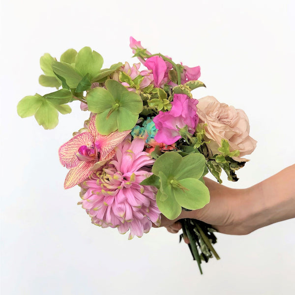 A beautiful tussy mussy in our signature Stacy k Floral style. A tussy mussy is a handheld bouquet consisting of a few blooms. It's super easy, just select the color variation your prefer, let us know any of your favorite blooms in the notes section of your order, add all items you need to your cart. Place your order for the selected delivery date and we will take it from there. The bouquet ribbon color will be chosen to accentuate the flower, if you prefer a certain color let us know in the notes.