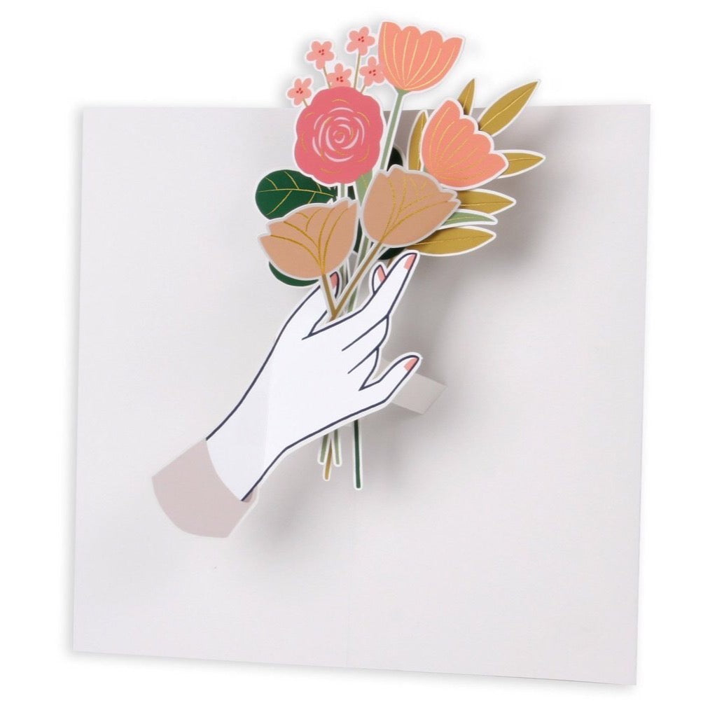 "A hand delicately holds a fresh bloom. Featuring gold foil and a gold envelope.   Front Greeting: for you Inside Greeting: blank Size: 4"" x 8"""