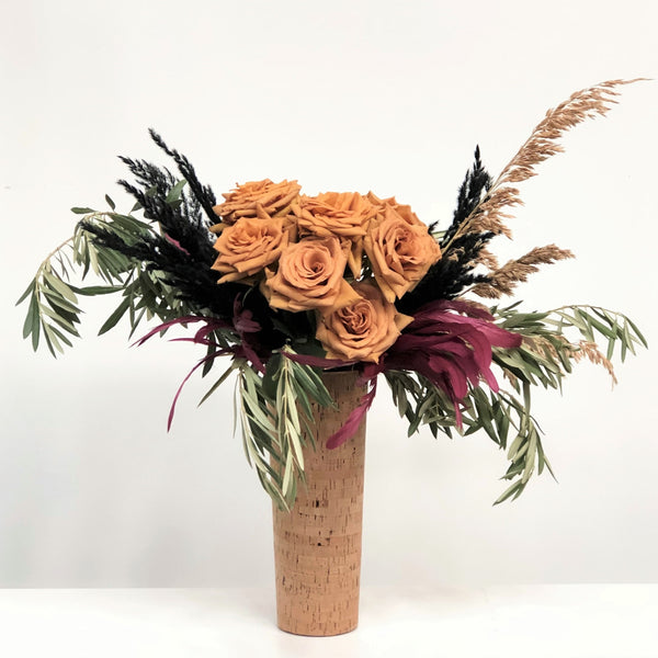 Stacy K Floral | Florist Rochester NY | The Fall Luxury Arrangement stands tall in a neutral vase. Toffee roses stand out among branching greenery and pampas grass.   **If toffee roses are unavailable they will be substituted for a different fall color rose**