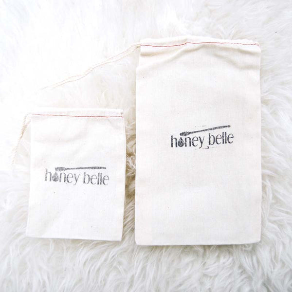 Complete the gift with a keepsake Honey Belle cotton bag with drawstring.
