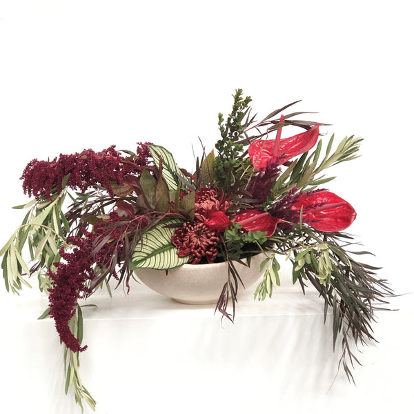 Stacy K Floral | Florist Rochester NY | This fall centerpiece is full of lush seasonal greens with complimenting floral in warm autumnal tones. Fall foliage adds color and texture to this stand out arrangement.