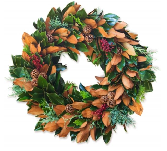 Magnolia wreath with berries and pinecones