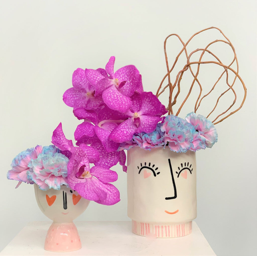 Heart eye vase set with orchids carnations and curly willow