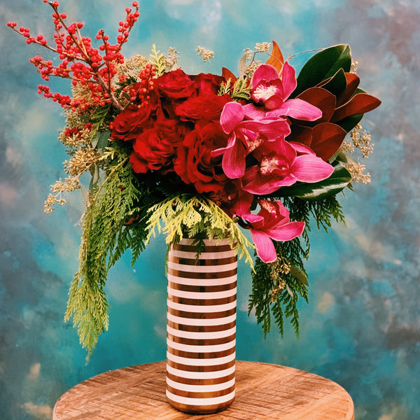 Dozen  roses with orchids in striped vase