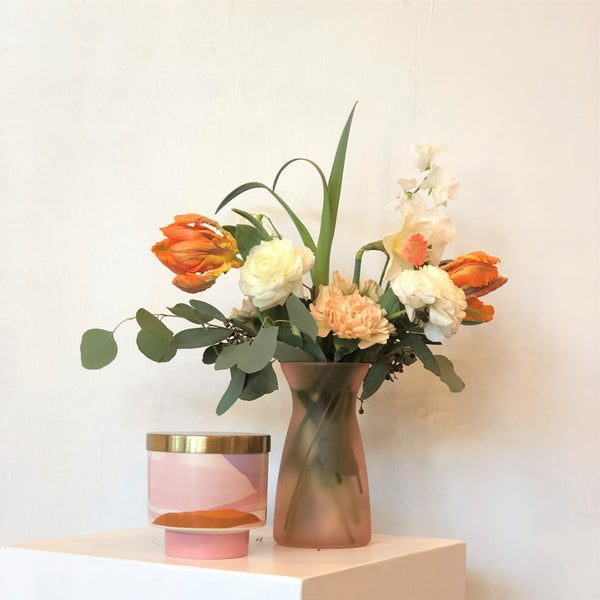petite peach and white arrangement with candle
