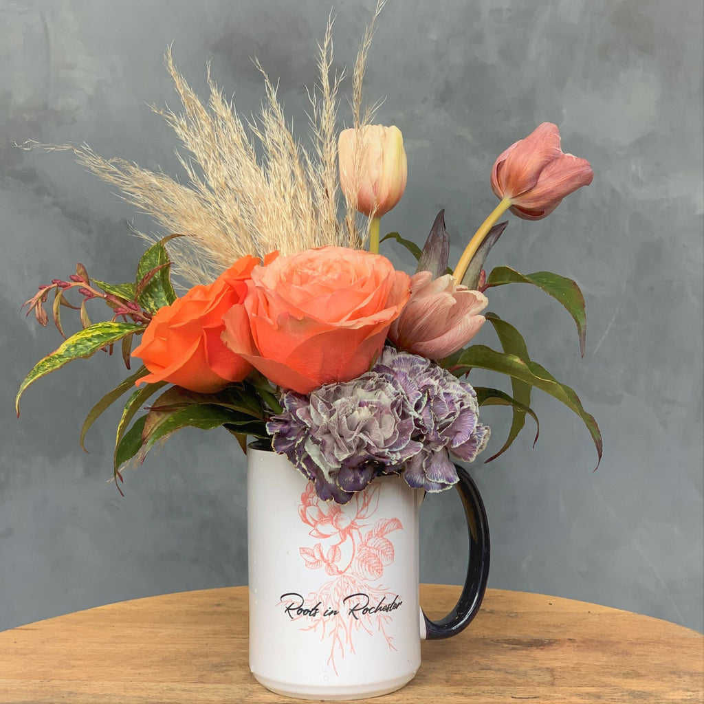 Roots in Rochester mug with flowers