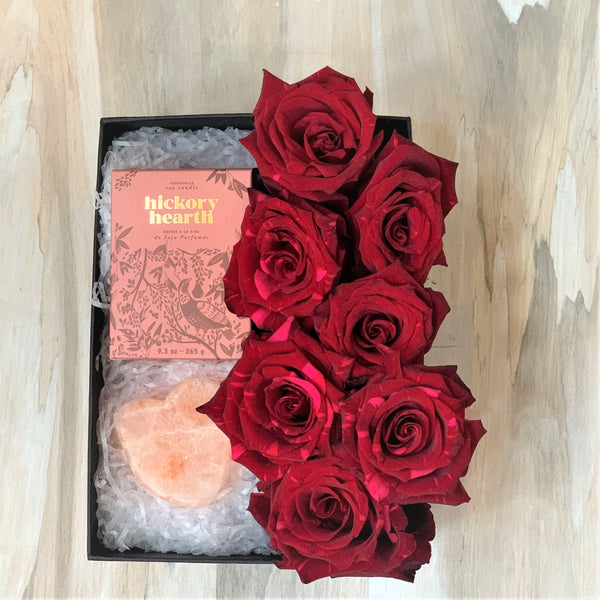 Gift box of red roses, candle and salt rock