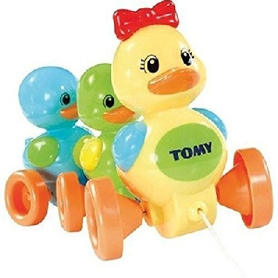 Tomy Quack Along Ducks Great Way To Encourage Play And To Develop Your Baby's Early Skills Pull The Cord And Hear Them Play A Happy Quack-Quack Song As They Merrily Waddle Along Loveable, Friendly Duckling Characters In Bold, Bright Colors Make Learning To Walk Great Fun! Inspires Playtime And Gets Toddlers Toddling! Encourages Hand-Eye Coordination Loveable, friendly duckling characters in bold, bright colours make learning to walk great fun! *Suitable For Ages 10M+