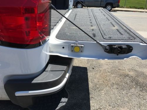 The HiddenHook Extendable Cargo Retrieval Tool stored securely in the tailgate