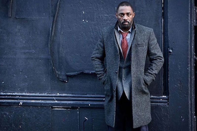 Idris Elba wearing a texturally layered outfit. (Photo credit: BBC)