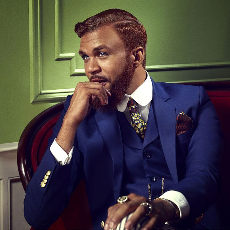 Jidenna wearing a navy blue suit.