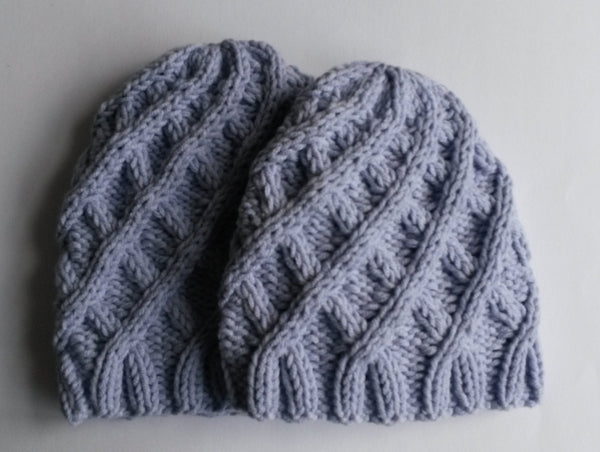 Aran Baby Hat: handknit baby cap in soft Rowan yarn. Made in Ireland. Sizes available - newborn, 6 to 9 month. Original design. Cute & cosy!