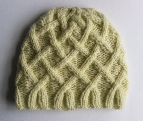 Aran Baby Beanie: handknit baby hat in luxury Rowan baby yarn. Made in Ireland. 3-6 month size. Original design. Unisex pastel yellow cap
