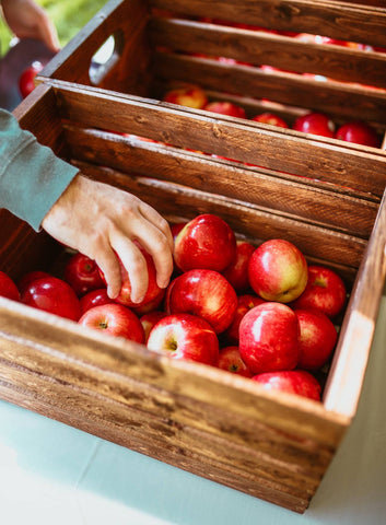 red apples in wood crate