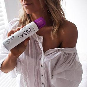 woman wearing MineTan Violet Self Tan Foam