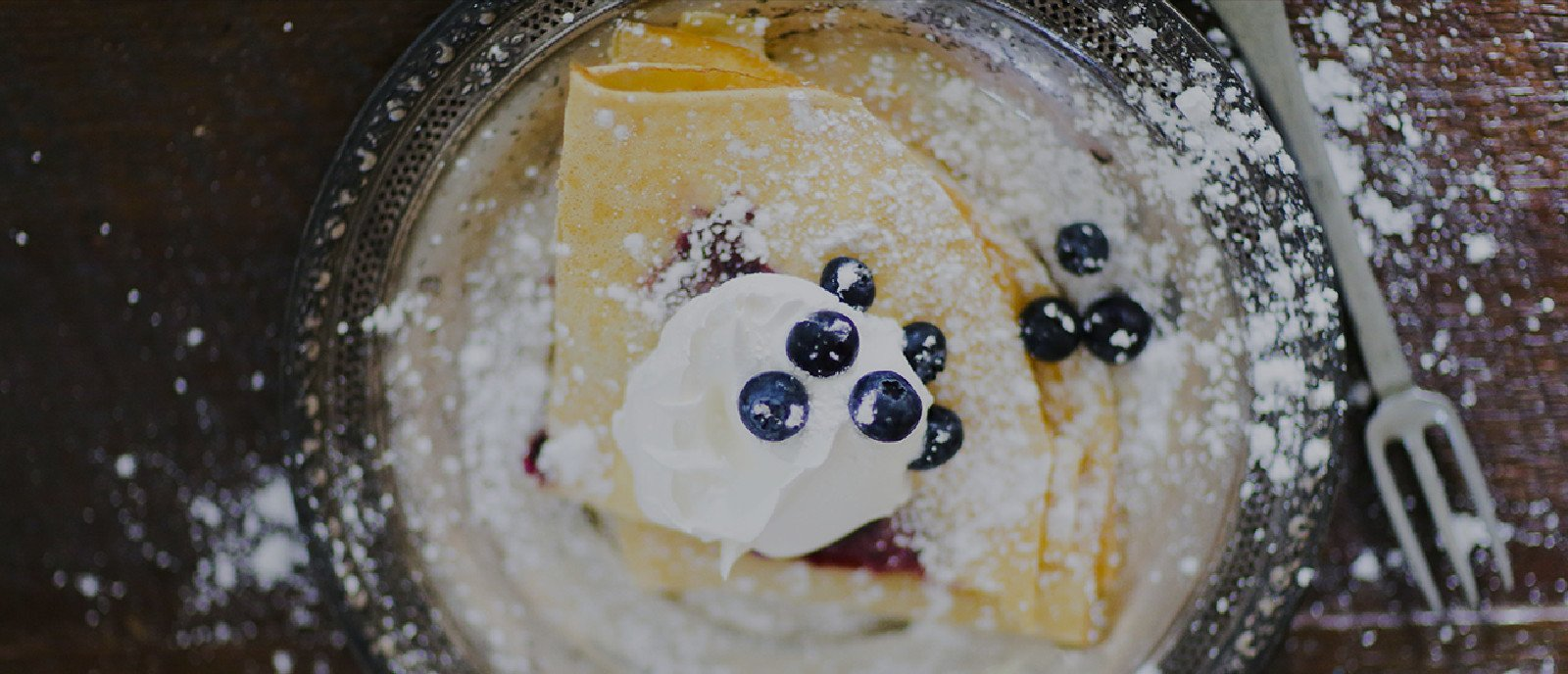 Recipe Photo of Crepes with Blueberry Syrup and whipped cream