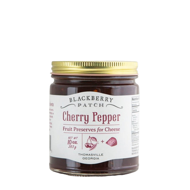 10oz glass jar of Blackberry Patch Cherry Pepper Fruit Preserves for Cheese with gold screw on lid.