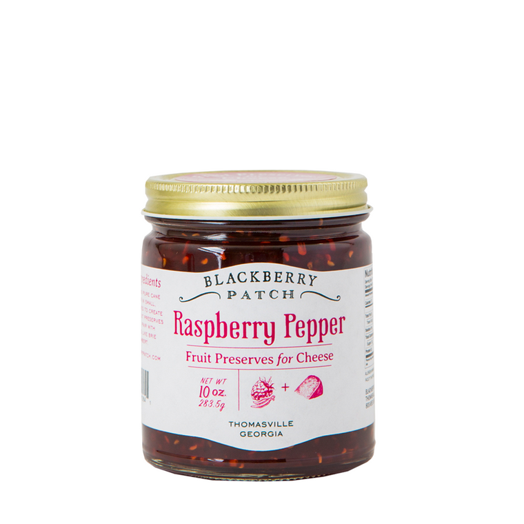10oz glass jar of Blackberry Patch Raspberry Pepper Fruit Preserves for Cheese with gold screw on lid.