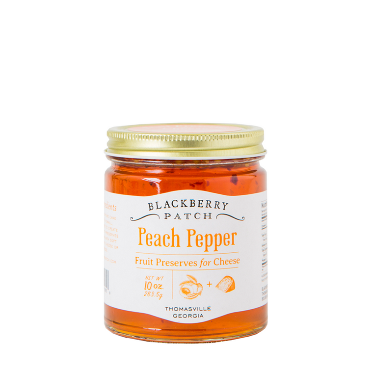 10oz glass jar of Blackberry Patch Peach Pepper Fruit Preserves for Cheese with gold screw on lid.